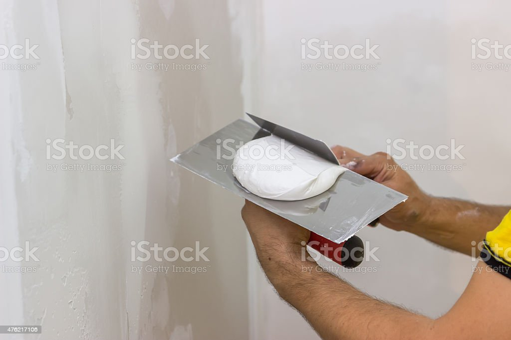 Mixing skimming plaster on trowel 2 stock photo