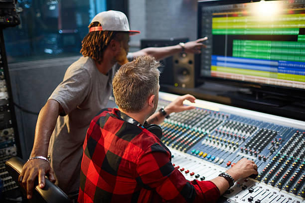 mixing sounds - producer stock pictures, royalty-free photos & images