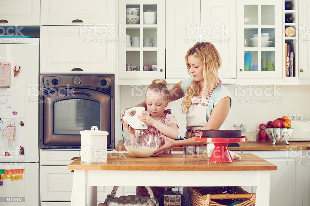 Mixing up the ingredients together royalty-free stock photo