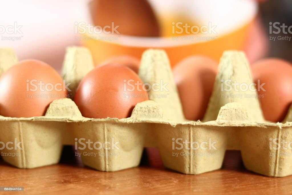 Mixing yolks with sugar and salt. Making mayonnaise with a wooden spoon. Lizenzfreies stock-foto
