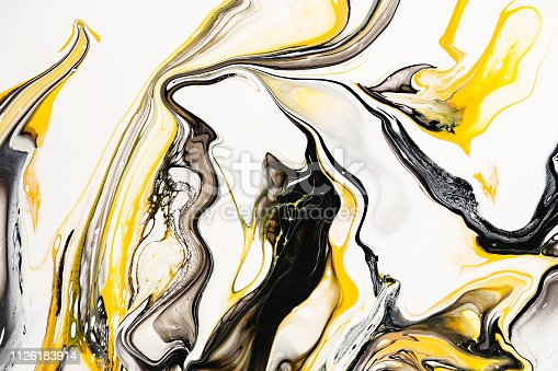 istock Mixture of acrylic paints. Modern artwork. Yellow and black mixed acrylic paints. Liquid marble texture. Applicable for design packaging, labels, business cards, and interactive web backgrounds. 1126183914