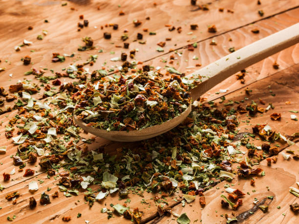 Mixture of dried vegetables on wooden spoon