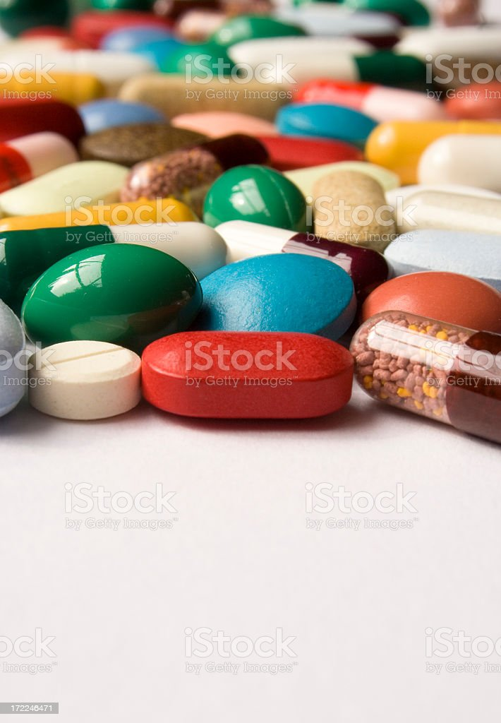 A mixture of drug tablets on white royalty-free stock photo