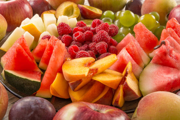 A mixture of their fruit, close-up. A mixture of their fruit. Peach, grapes, apple, watermelon, melon, raspberry, plum. Juicy and ripe pieces of fruit close-up. fruit stock pictures, royalty-free photos & images