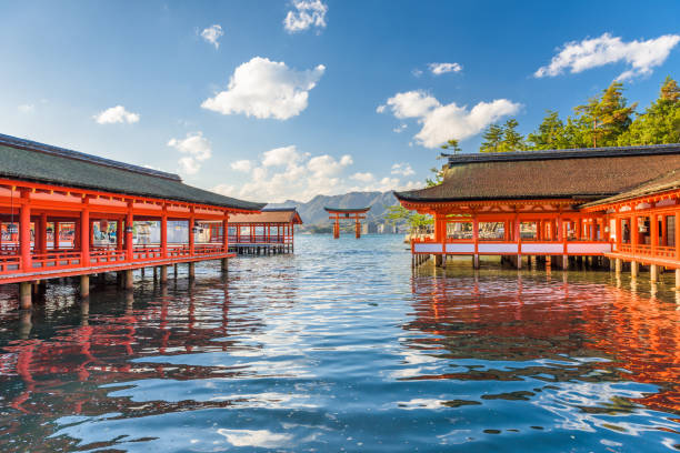Miyajima, Hiroshima, Japan at Itsukushima Shrine Miyajima, Japan - December 3, 2015: The famous floating gate of Itsukushima Shrine with the tide rolling in. The shrine has a history extending back to the 6th century. hiroshima prefecture stock pictures, royalty-free photos & images