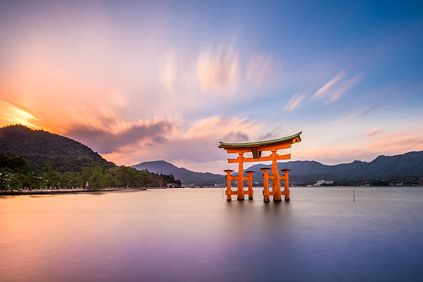 Miyajima, Hiroshima, Japan Hiroshima, Japan - December 3, 2015: The Floating Tori Gate of Itsukushima Shrine off the coast of Miyajima Island. The shrine dates from the mid-16th century. shinto shrine stock pictures, royalty-free photos & images