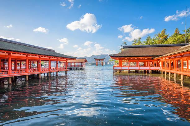 Miyajima, Hiroshima, Japan Miyajima, Japan - December 3, 2015: Itsukushima Shrine and the famed floating tori gate during high tide. miyajima stock pictures, royalty-free photos & images