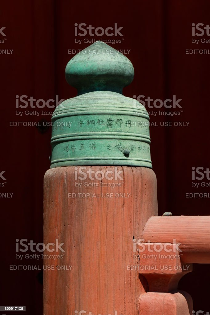 Miyajima - Japan, May 26, 2017: Decoration in the shape that resembles leek flowers are placed on the railing posts of the five-storied pagoda stock photo