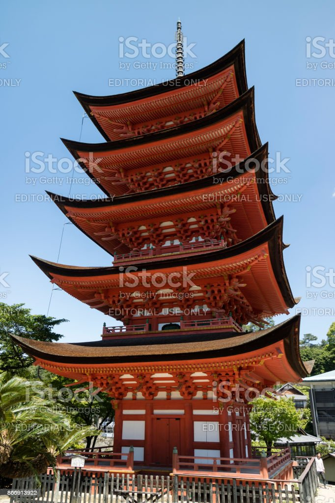 Miyajima - Japan, May 26, 2017: Historic vermillion wooden Five-storied Pagoda, Gojunoto, located in front of the entrance to Itsukushima Shrine stock photo