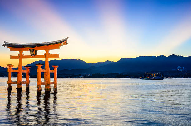 Miyajima Torii Gate in Japan Miyajima, Japan - July 15, 2011: The famed Tori Gate at Itsukushima Shrine on Miyajima Island in Hiroshima Prefecture. The shrine was founded in the 6th Century and the current gate dates from 1875. itsukushima shrine stock pictures, royalty-free photos & images