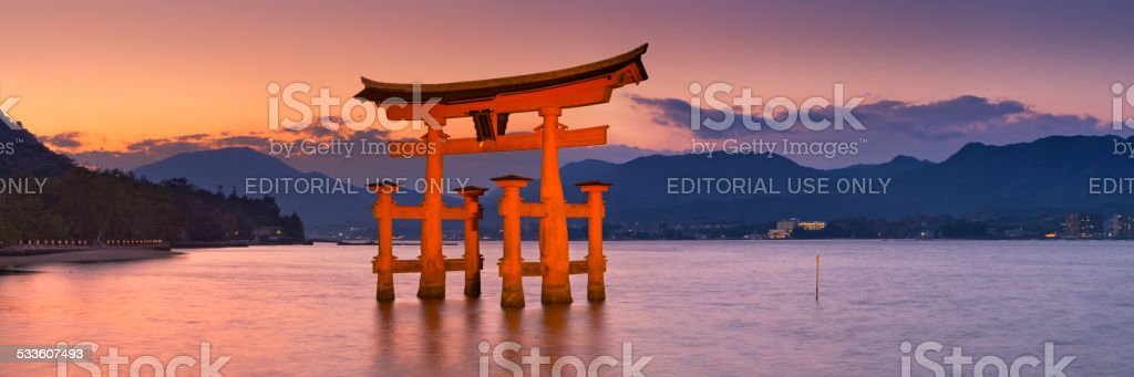 Miyajima torii gate near Hiroshima, Japan at sunset stock photo