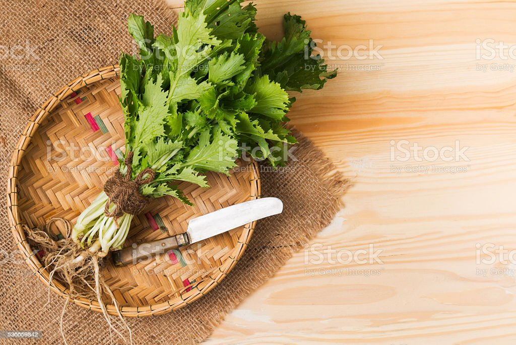 mizuna vegetation in basket stock photo