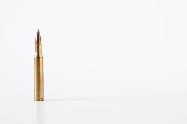 7.62 mm Caliber Bullet Isolated on White Background stock photo