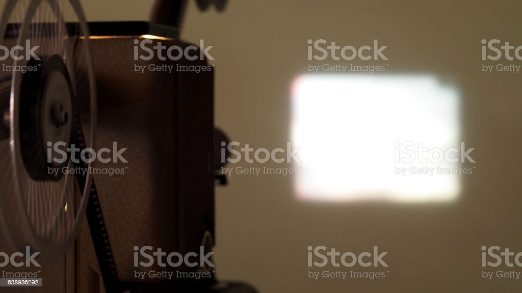 8 mm projector running with vintage film stock photo