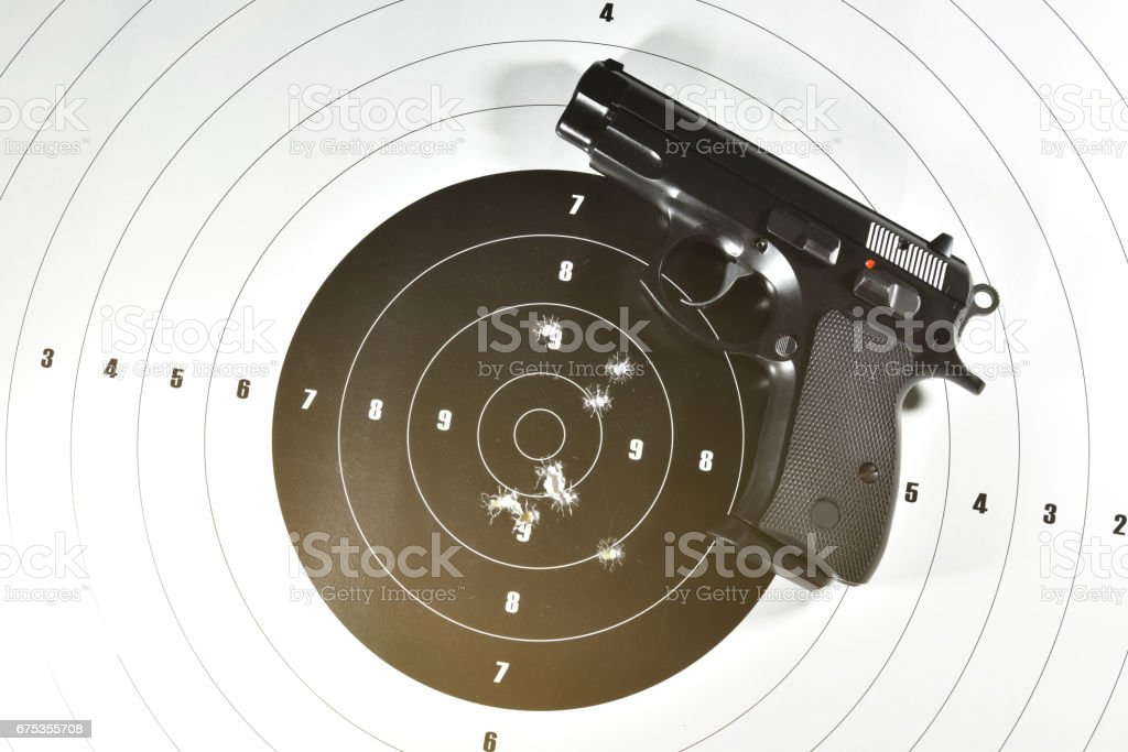 9 mm. semi automatic handgun and shooting target stock photo