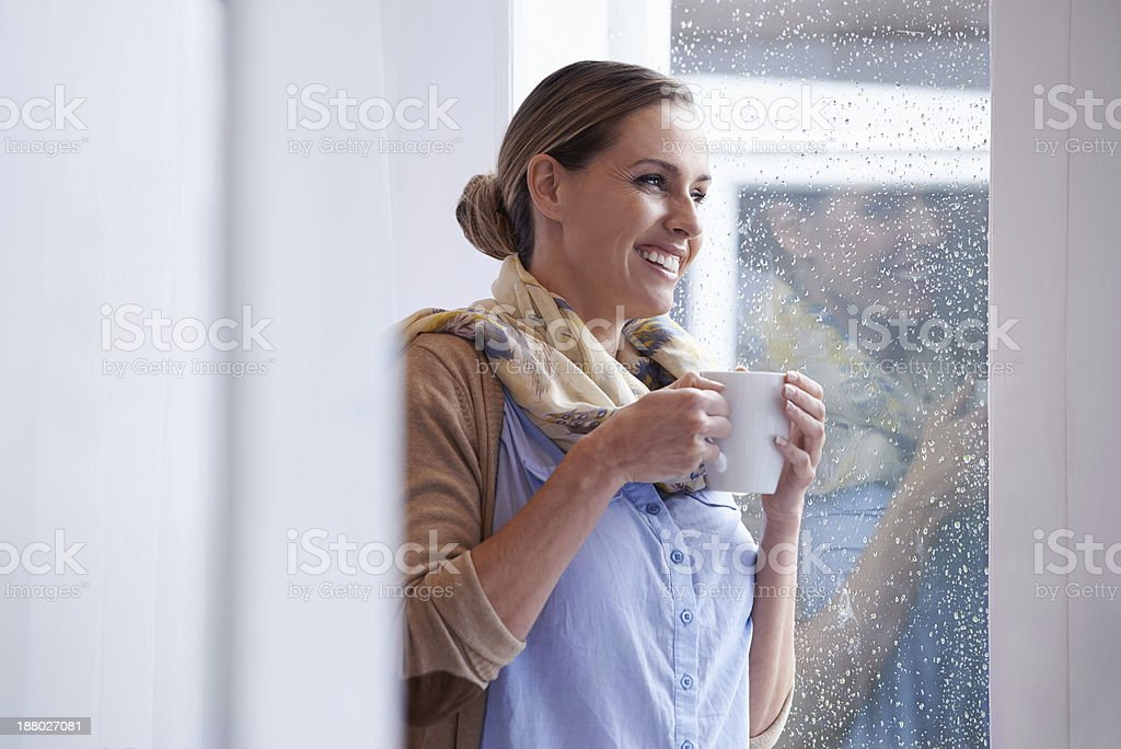 Mmm, hot coffee on a rainy day..such bliss! stock photo