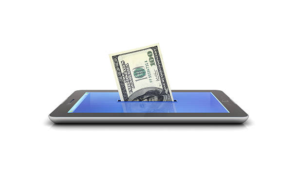 mo and tablet making money stock photo