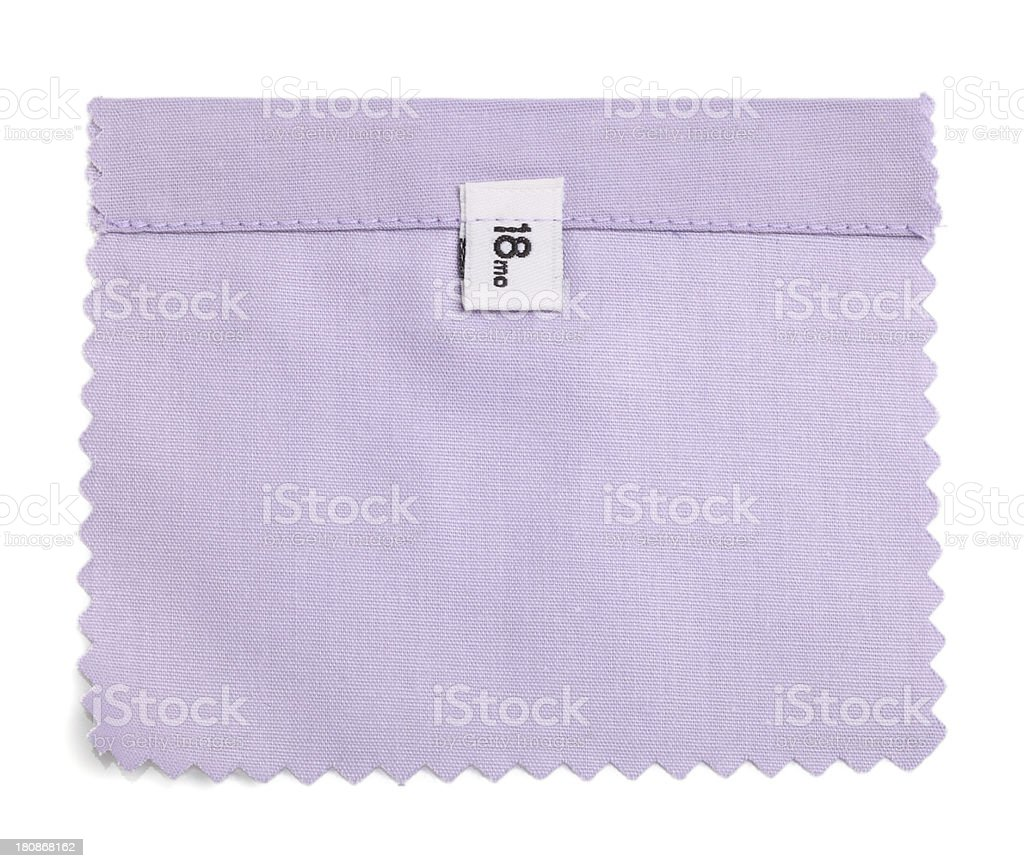 18 Mo Labeled Beige Fabric Swatch royalty-free stock photo