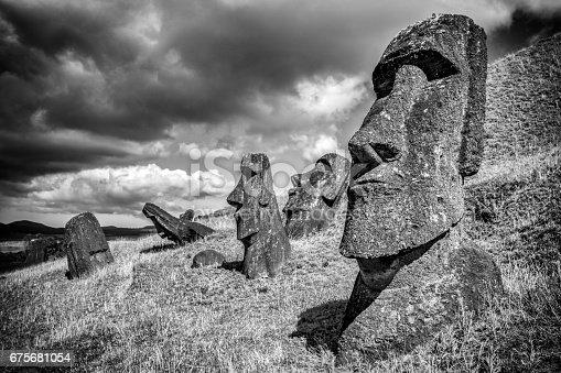 Rano Raraku Easter Island Moai Statues under dramatic skyscape. Black and White. Rano Raraku, Rapa Nui National Park, Hanga Roa, Easter Island, Isla de Pascua, Chile
