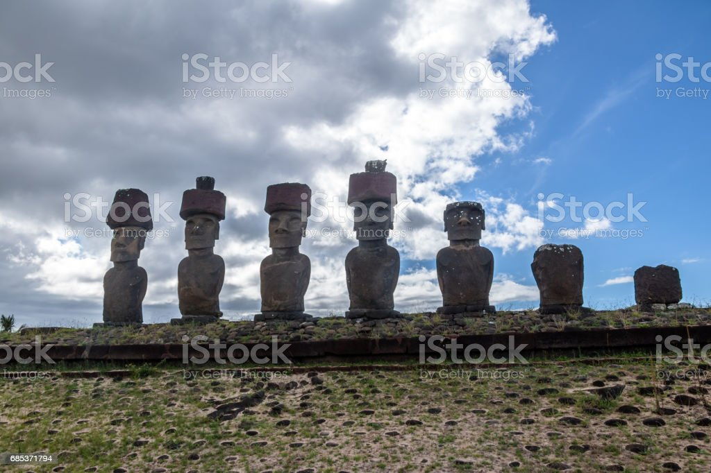 Moai Statues of Ahu Nau Nau wearing topknots near Anakena Beach - Easter Island, Chile stock photo