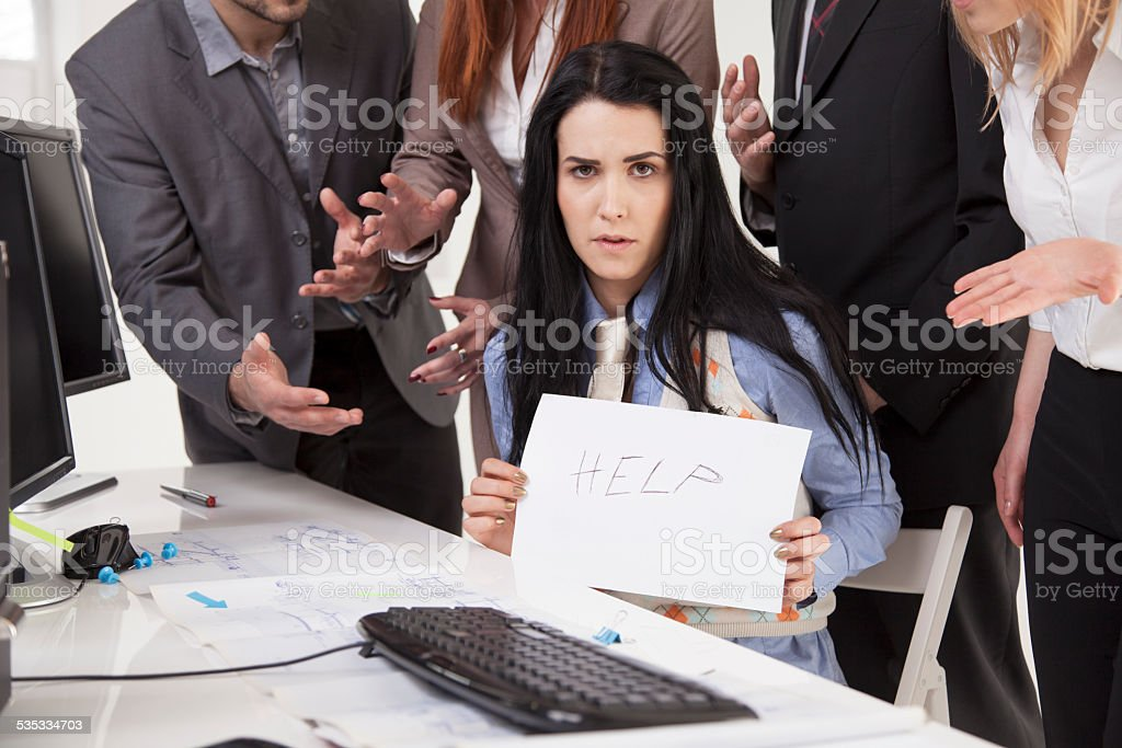 Mobbing at work - help me sign stock photo