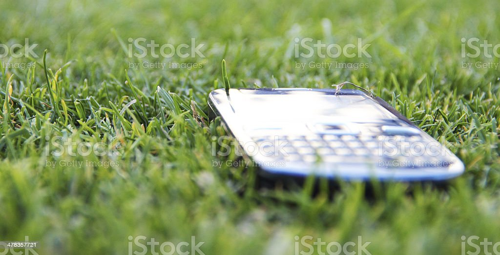 Mobil phone on grass stock photo