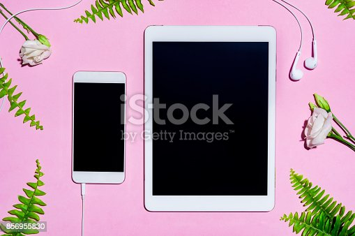 istock Mobile and digital tablet on pink 856955830