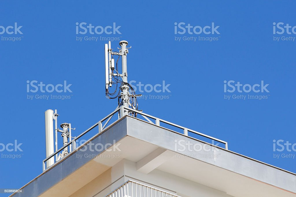 Mobile antenna in a building stock photo
