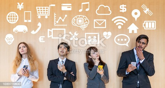 istock Mobile app concept. Group of businesspeople. 1033720800