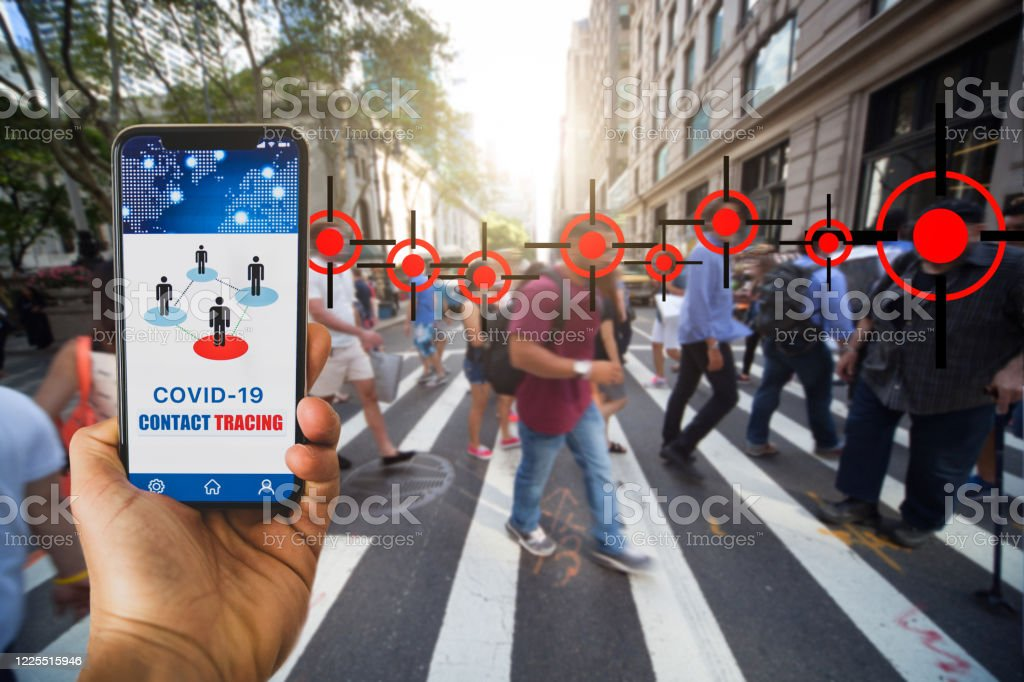 Mobile APP contact tracing adopted by national Governments to stop Covid-19 pandemic Mobile APP contact tracing adopted by national Governments to stop Covid-19 pandemic. This image is in New York City.  Note for inspectors: All the elements in the image are produced by me. Accidents and Disasters Stock Photo