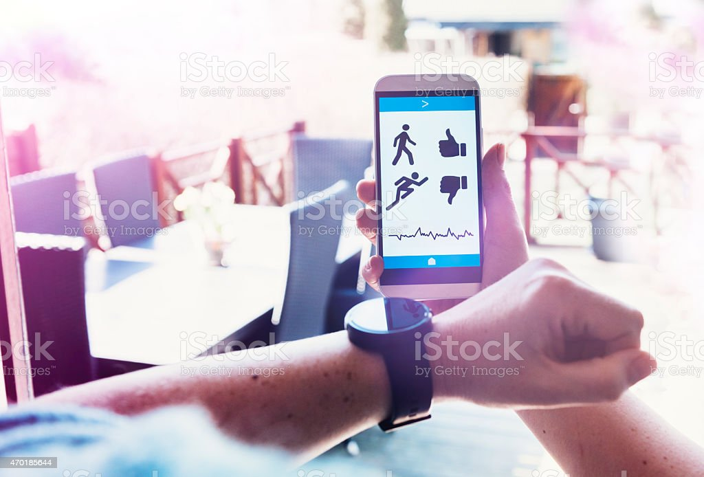 Mobile app tracks fitness and connects to smart watch stock photo