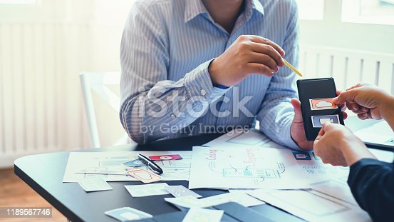 1133505958 istock photo Mobile application designers plan together in the office. 1189567746