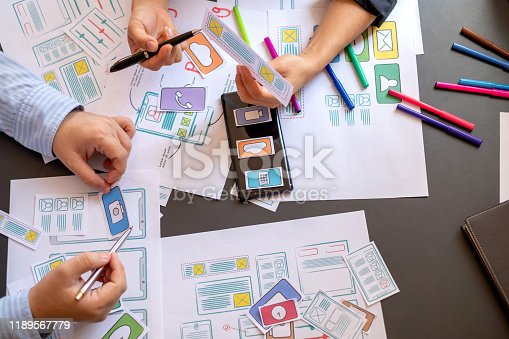 1133505958 istock photo Mobile application designers plan together in the office. 1189567779