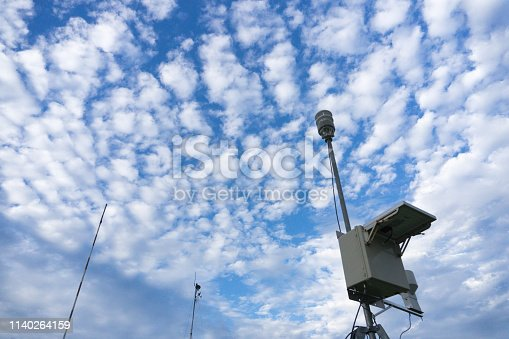istock Mobile automatic weather station under the bright blue sky and altocumulus clouds 1140264159