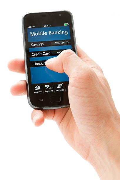 мобильный банкинг на смартфоне-generic - hand holding phone стоковые фото и изображения
