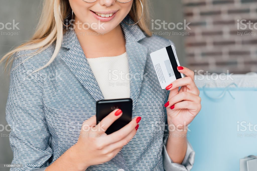 mobile banking online shopping woman credit card stock photo