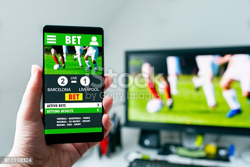 istock Mobile betting on soccer match on smart phone app 911119324