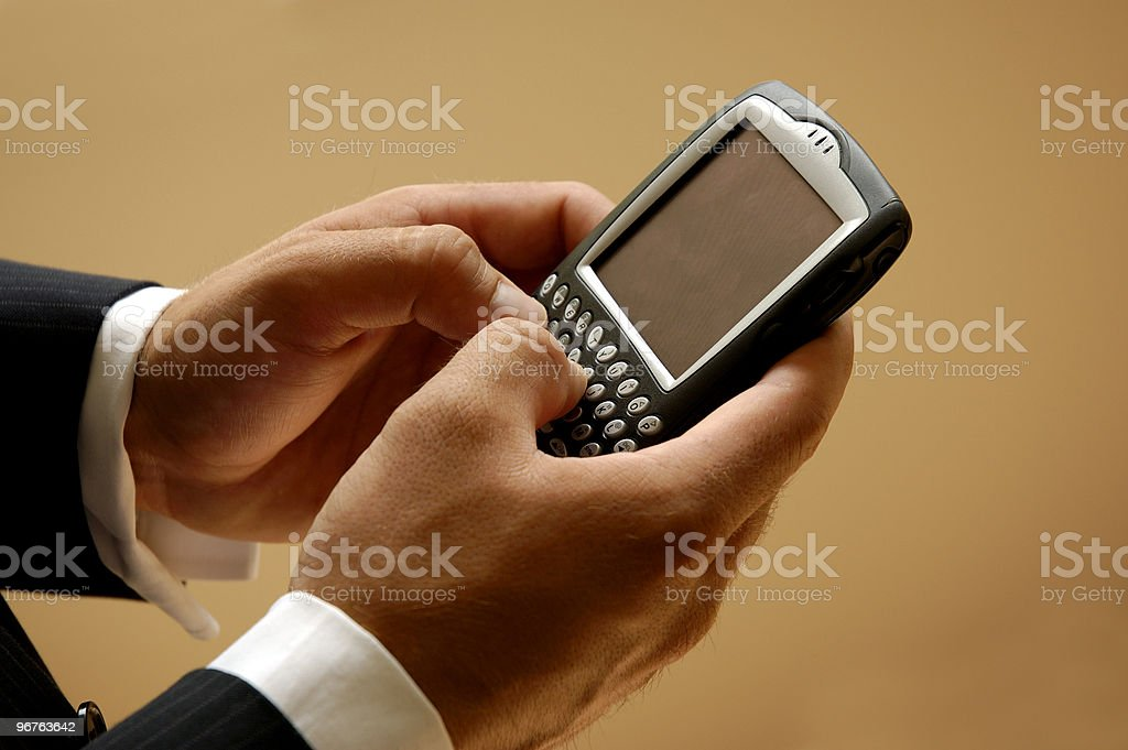 Mobile Businessman Sending A Text Message royalty-free stock photo