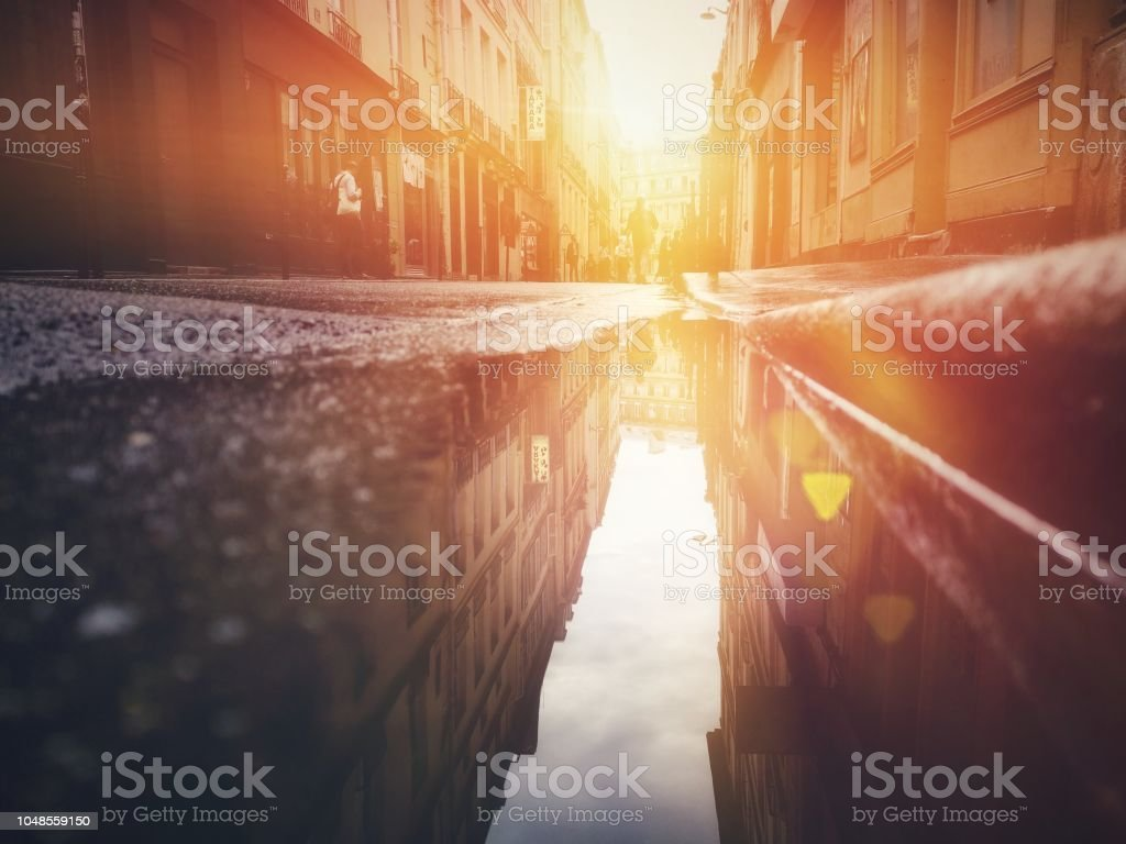 mobile camera image paris sunset low angle with reflection on ground