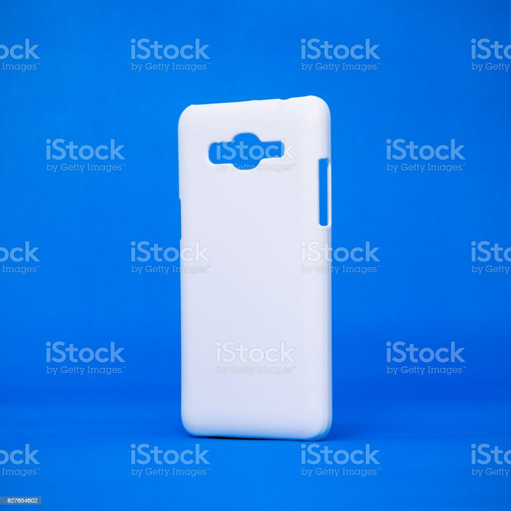 Mobile cases on vivid blue backdrops. Phone cover for your design. Smartphone accessory or trendy fashion. stock photo