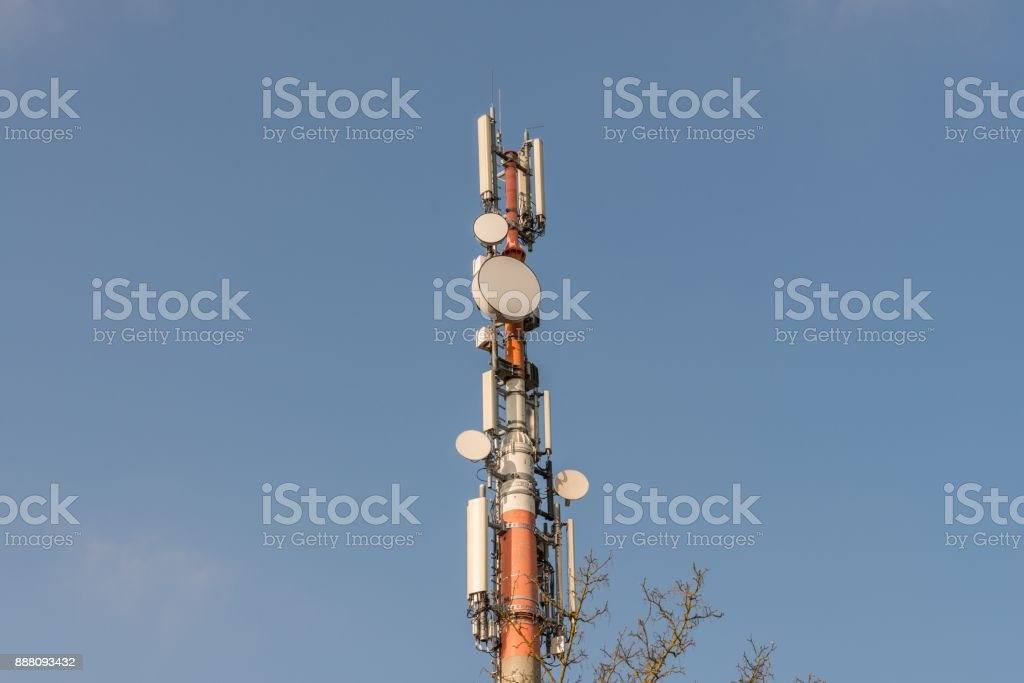 Mobile Cell tower in front of blue sky, Germany stock photo
