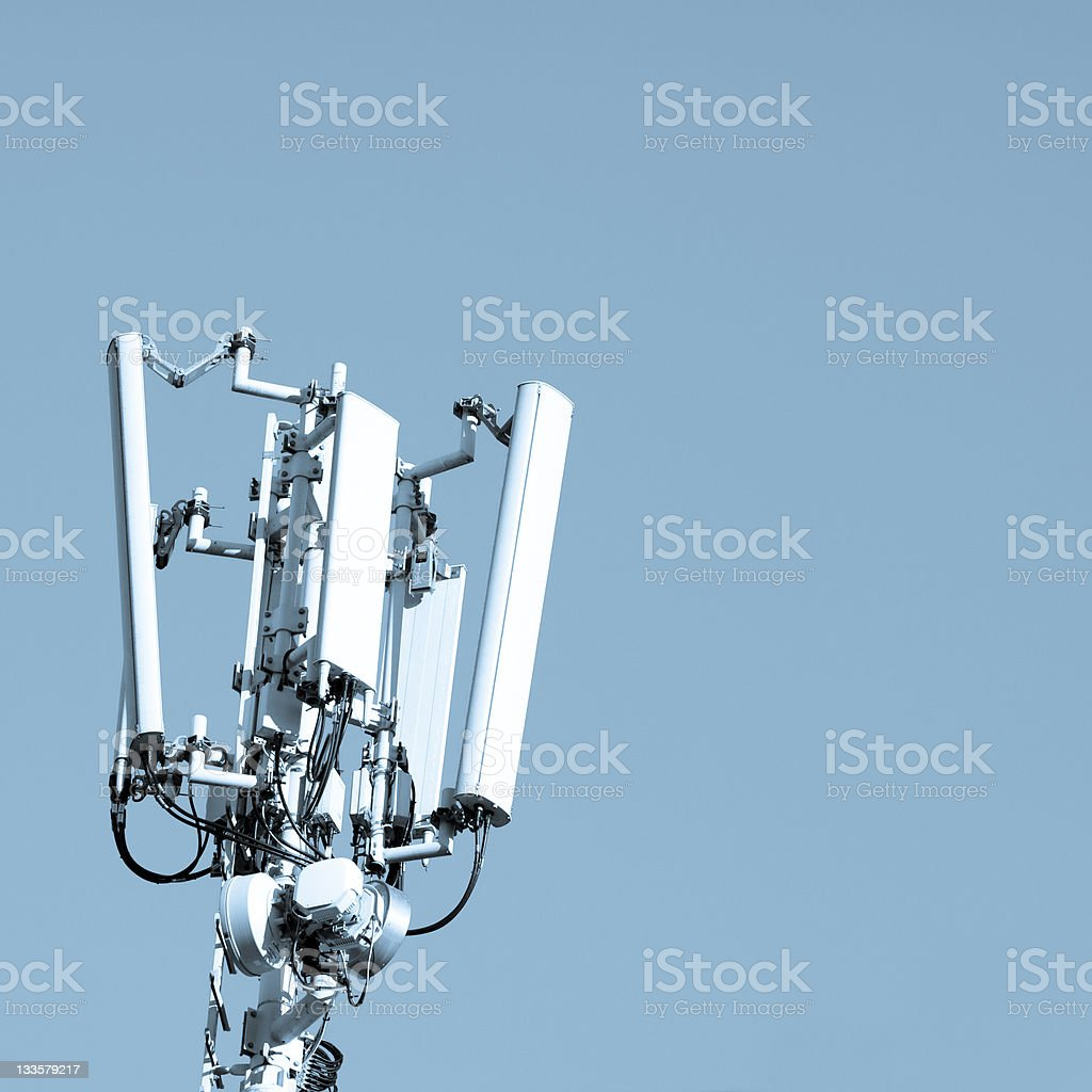 Mobile Communication Tower Against a Blue Sky, Technology Background stock photo