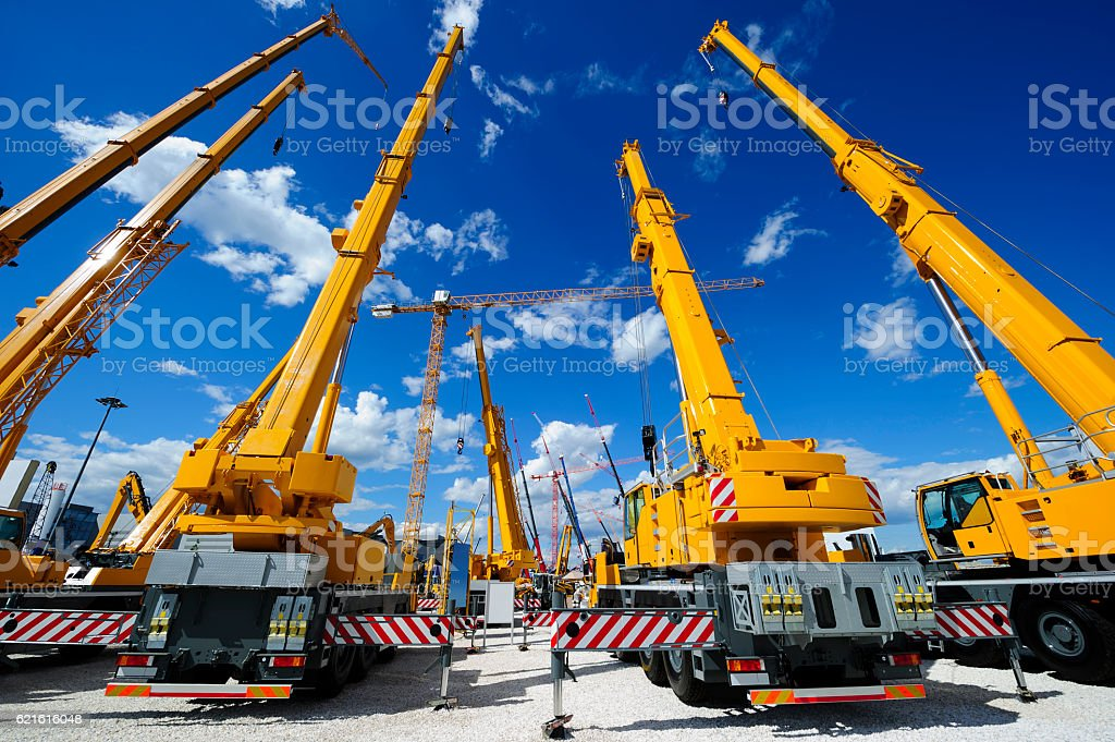 Mobile construction cranes stock photo