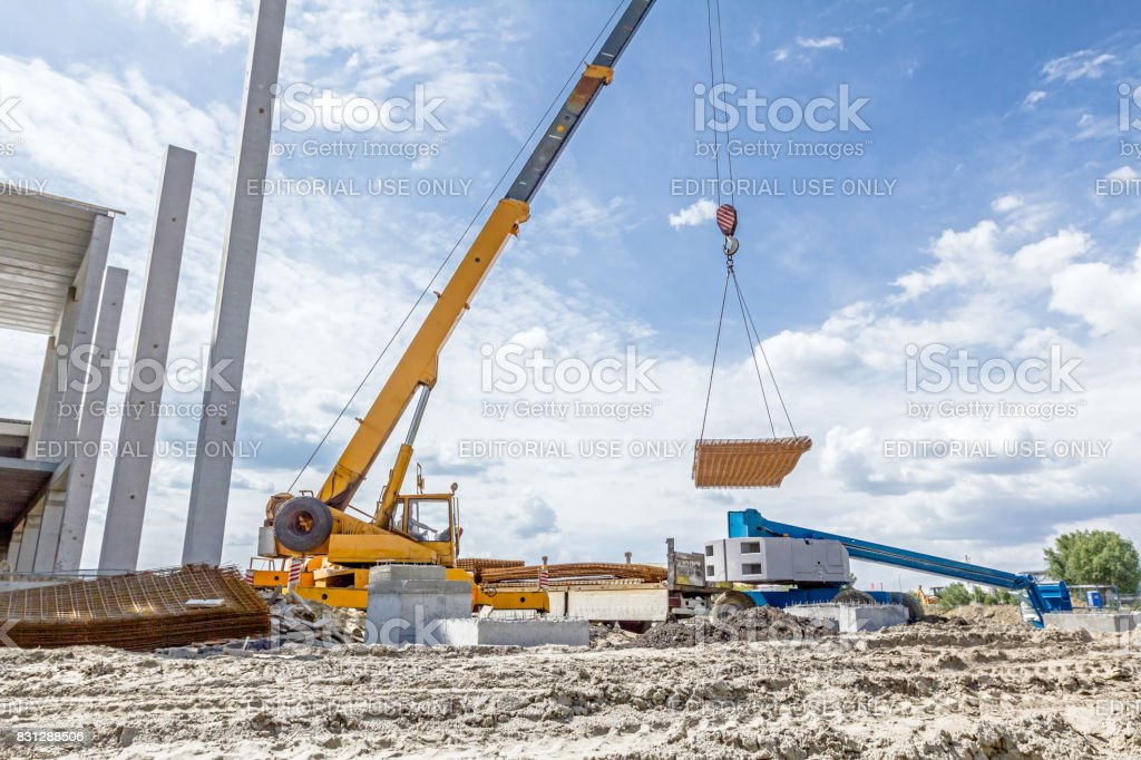 Mobile crane is carry pile of reinforcing mesh for concrete stock photo