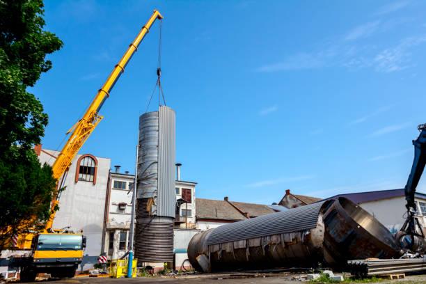 Mobile Crane Lay Down Big Old Metal Tank Stock Photo & More
