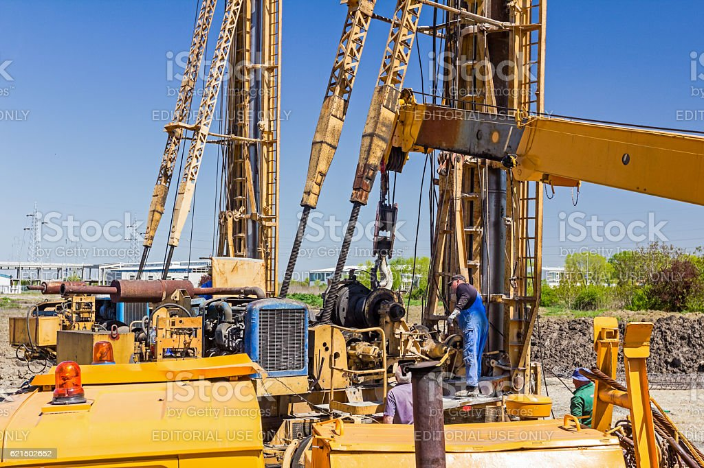 Mobile crane on truck is loading spare part. Lizenzfreies stock-foto