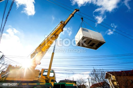 istock Mobile crane operating by lifting and moving electric generator 469734207