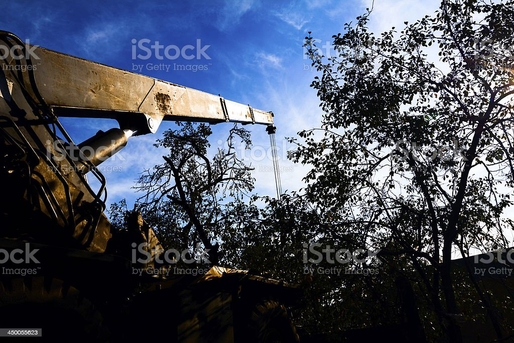 Mobile crane with risen boom into a blue sky royalty-free stock photo