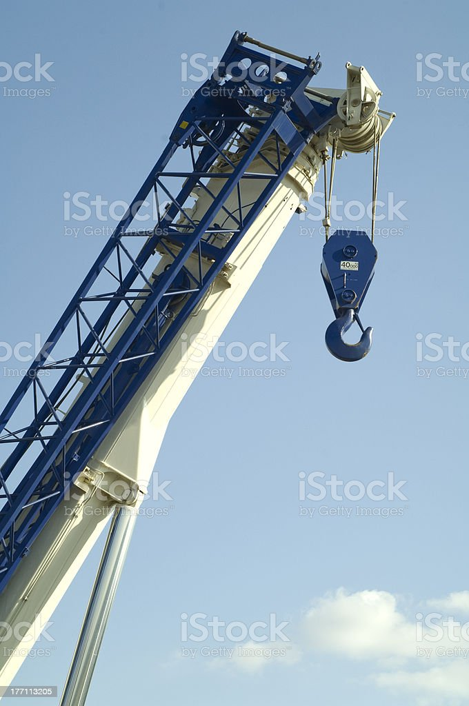 mobile crane with risen boom outdoors stock photo
