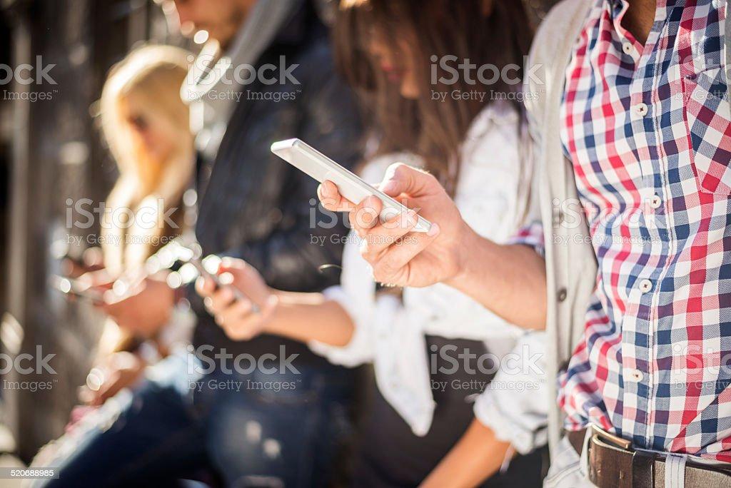 Mobile device addiction stock photo